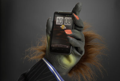 Hairy hand businessman holding phone